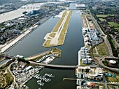 Aerial view City Airport from the east. Old Royal Docks, University of East London, Thames Barrier and Excel exhibition Centre