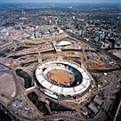 Aerial view of the Olympic Stadium and Aquatics Centre during construction, London, UK.