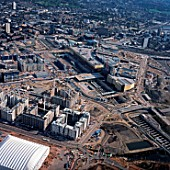 Aerial view of the Olympic Basketball Arena, Athletes village and Stratford Station, London, UK.