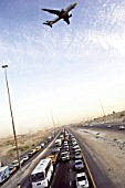Emirates Road traffic jam, aeroplane flying overhead, Dubai, United Arab Emirates, May 15, 2005.