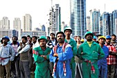 Workers watch fire at Jumeirah Lake Towers, Dubai, United Arab Emirates, January 18, 2007.