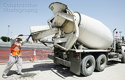 Mixer uploading concrete into MRT post at the corner of Ettihad and Al Wahida Street in Abuhail Duba