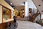 Disabled man at reception in church building