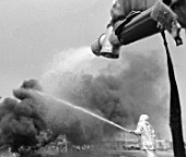 Fire fighters hosing down a fire on an oil field, Poltava, Ukraine, September 1985