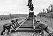 BAM (Baikal-Amur Mainline) builders lay the rails, Sakha Republic, Russia, 1978