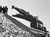 A track laying vehicle passes the last bridge of the Small BAM (Baikal-Amur Mainline), Sakha Republic, Russia, October 1977
