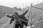 A land-surveyor using a lever during the construction of the Kakhovsky Irrigation Canal, Ukraine, USSR, 1978