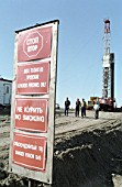 A warning sign at the entrance of one of KomiArctic Oil drilling sites. Verkhne-Vozeiskoiye oil field, Komi Republic, Russia, 1994