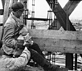 A worker at the construction of Magnitogorsk Iron & Steel Works, Magnitogorsk, Russia, 1930