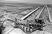 Construction machines laying an irrigation canal in the Golodnaya steppe, Uzbekistan, USSR, 1977