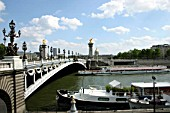 Paris, France 2005. Pont dAlexandre III is the most beautiful of Parisian bridges. Emperor Alexander III of Russia laid its foundation stone in 1886. The end of construction was timed to the opening of the World Exposition of 1900.