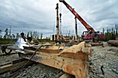 Preparation of bridge supports for Amur-Yakutsk main railway construction, Sakha Republic, Russia, 2005