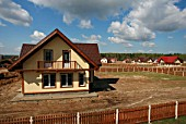 Cottages under construction at the Slavenka summer house settlement in the Isrta district, Moscow Region, Russia, 2006