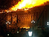 Sixty fire-fighting teams operating from Mokhovaya Street, Alexander Garden and Manezh Square tried to extinguish blaze that swept the Moscow-based Manezh building, Moscow, Russia, 2004