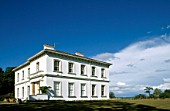 Ballyscullion Park House under blue sky, Londonderry, Northern Ireland.