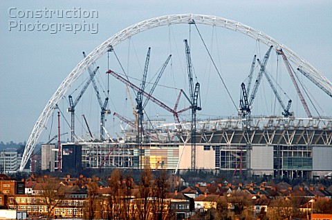 New Wembley Stadium under construction in January 2005 looking at the arch and cranes across rooftop