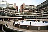 Ice skating in Broadgate Centre, City of London, UK