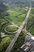 Aerial view south-west view of M11 motorway junction 5 and A1168 in Chigwell, Epping Forest, UK