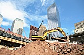 A front loader moves an old steel column near Seacant Wall on World Trade Center, Lower Manhattan, New York City, USA