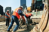 Workers drill and shovel near Tower One at World Trade Center site, Lower Manhattan, New York City, USA