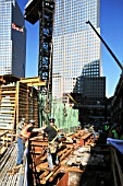 Workers move steel beam at Tower One site, Lower Manhattan, New York City, USA