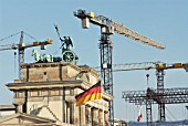 Tower cranes constructing new Embassy of USA  beside historic Brandenburg Gate in Berlin