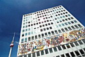 Soviet era office building with political murals in former East Germany at Alexanderplatz in Berlin