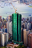 Highrise apartment building under construction in Hong Kong with Victoria Harbour and Kowloon to rear 2008