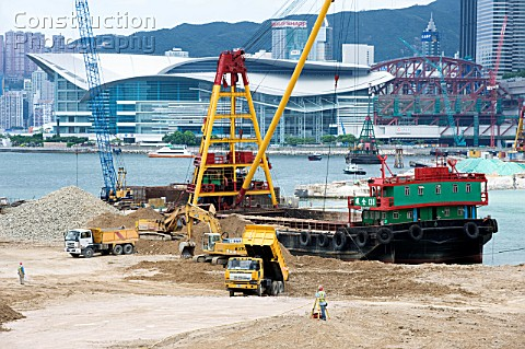 Major land reclamation construction in progress in Victoria Harbour in Hong Kong with the Hong Kong