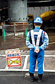 Security guard at entrance to large office tower construction site in central Tokyo 2008