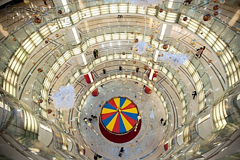 Interior view of spectacular circular atrium inside modern new Joy City shopping mall in Xidan distr