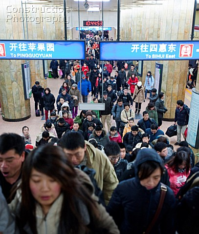 Commuters in a busy subway station in Beijing 2009