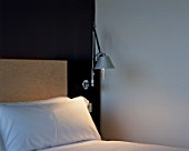 View of a lamp beside a bed