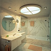 View of an illuminated bathroom with a skylight