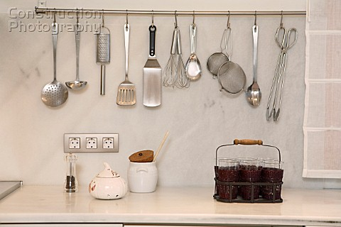 A151 00268 View Of Kitchen Tools Hanging On Wall