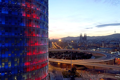 Sunset partial view of Barcelona city Agbar Tower and Monument Sagrada Familia Barcelona Spain  of S