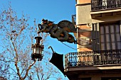 Detail of one dragon and lamp and umbrella in Las Ramblas, Barcelona, Spain