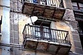 View of an old balcony with a satellite dish