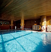 View of an interior swimming pool with a wooden ceiling
