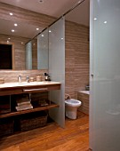 View of a well designed bathroom with hardwood flooring