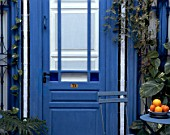 Partial view of a blue door