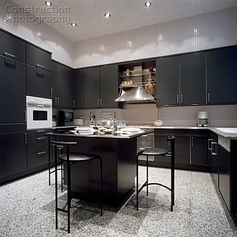 View of a kitchen having black cabinets