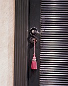 Close-up of the tassel on the handle of a door