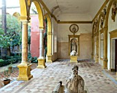 Statue and pillars in patio with tile flooring,casa de pilatos,Seville,Spain