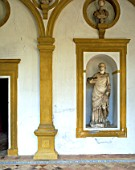 Old statue on painted wall,casa de pilatos,Seville,Spain