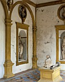 Old statues on wall with pillars,casa de pilatos,Seville,Spain