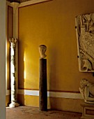Old statue and column with painted wall and wall casa de pilatos,Seville,Spain