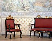 Living room traditional chair and wall art,Casa Pilatos,Sevilla,Spain