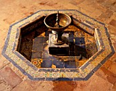 Old fountain with tile flooring,Casa Pilatos,Sevilla,Spain