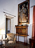 Armchair in a living room with framed picture and drawer,Casa Pilatos,Sevilla,Spain